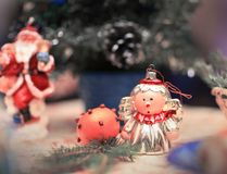 Christmas angel and Santa Claus on the decorated holiday table royalty free stock images