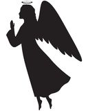 Christmas angel. Silhouette of a Christmas angel in profile with her hands folded in prayer Royalty Free Stock Photos