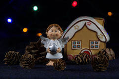 Christmas angel with a silver star. Royalty Free Stock Image