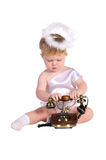 Christmas angel, small child with phone Royalty Free Stock Image