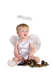 Christmas angel, small child with phone Royalty Free Stock Photography