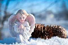 Christmas angel in the snow and blue sky. Little christmas angel in the snow and blue sky Royalty Free Stock Images
