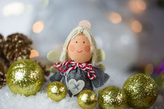 Christmas angel in the snow with Christmas tree balls Stock Photo
