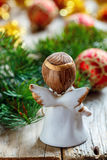 Christmas angel and spruce branches. Stock Photo
