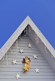 Christmas angel and stars on building Royalty Free Stock Photo