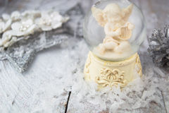 Christmas angel statuette on silver background Royalty Free Stock Photos