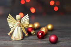 Christmas angel. Christmas straw ornament. On wooden background royalty free stock image
