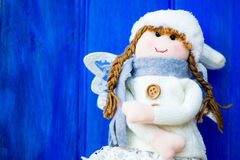 Christmas Angel in White Hat and Grey Scarf Royalty Free Stock Images
