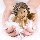Christmas angel - woman is holding them in her hands Stock Image