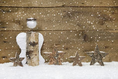 Christmas: Angel and wooden stars with snowflake design on woode Stock Photo