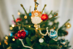 Christmas angel on a wooden table. On a background of trees royalty free stock photo