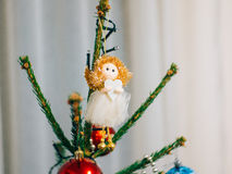 Christmas angel on a wooden table. On a background of trees royalty free stock images