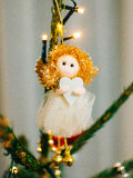 Christmas angel on a wooden table. On a background of trees stock images