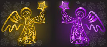 Christmas Angels. Two shimmering Christmas angel with stars on a black background Stock Photos