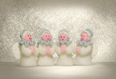 Christmas angels. Four christmas angels on bright background Royalty Free Stock Photos