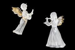 Christmas angels. Some Christmas figures made of ice representing two angels playing music Royalty Free Stock Photos