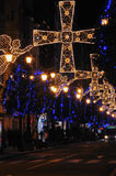 Christmas angels and crosses. Christmas lighting in the city Royalty Free Stock Images