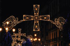 Christmas angels and crosses. Christmas lighting in the city Stock Photo