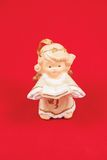 Christmas angels on a red background. Christmas decoration on a red background Royalty Free Stock Images