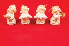 Christmas angels on a red background. Christmas decorations on a red background Stock Images