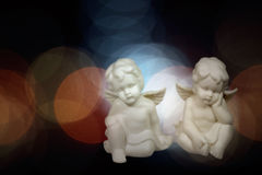 Christmas angels. Soft christmas angels against flare background. Used digital filters Royalty Free Stock Image