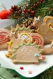 Christmas animal-shaped cookies with festive decorations Stock Photos