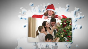 Christmas animations about families decorating a tree Royalty Free Stock Photos