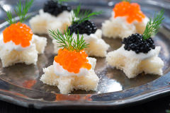 Christmas appetizers with bread and caviar, close-up Stock Photos