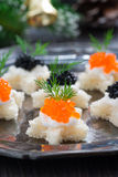 Christmas appetizers with bread and caviar, close-up Stock Photo