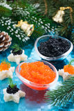 Christmas appetizers - red and black caviar, vertical Stock Photos