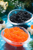 Christmas appetizers - red and black caviar, vertical, close-up Royalty Free Stock Images