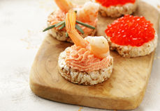Christmas appetizers. Small tartlets with caviar and pate. Stock Photography