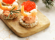 Christmas appetizers. Small tartlets with caviar and pate. Royalty Free Stock Photography