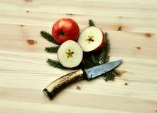 Christmas apple cutting Royalty Free Stock Photo