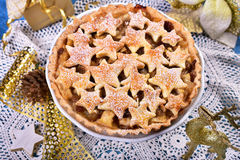 Christmas apple pie with star shape decoration Stock Images