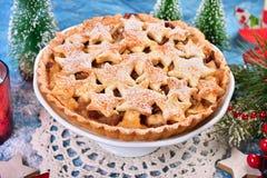 Christmas apple pie with star shape decoration Stock Photos