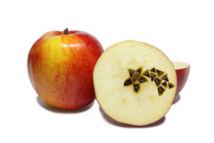 Christmas apples. Christmas motive - comet on section of apple on white background Royalty Free Stock Image