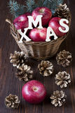 Christmas apples. Christmas still life with apples and pine cones Royalty Free Stock Photos