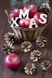 Christmas apples  on wooden table Royalty Free Stock Photos