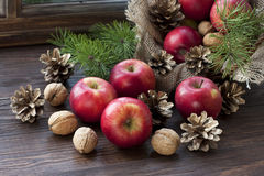 Christmas apples  on wooden table Stock Image