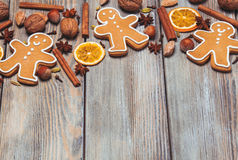 Christmas aroma decor. Gingerbreads with spices on the wooden table. Christmas aroma decor Stock Images