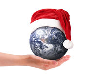 Christmas around the world. A Christmas around the world in a hand Royalty Free Stock Photo