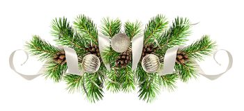 Christmas arrangemen with pine twigs, silver balls and ribbons. Christmas arrangement with pine twigs, silver balls and ribbons isolated on white background royalty free stock images