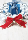 Christmas arrangement with baubles and gift box Stock Photo