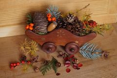 Christmas arrangement with berries and fir cones Royalty Free Stock Photo