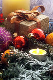 Christmas arrangement with candle Stock Photos