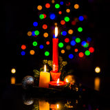 Christmas arrangement with candles and Christamas tree lights Royalty Free Stock Images