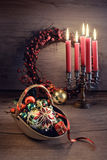 Christmas arrangement with candles on wooden table. Stock Photo