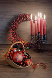 Christmas arrangement with candles on wooden table Stock Image