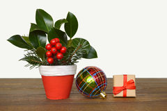 Christmas arrangement, Christmas gift and colorful bauble Stock Image